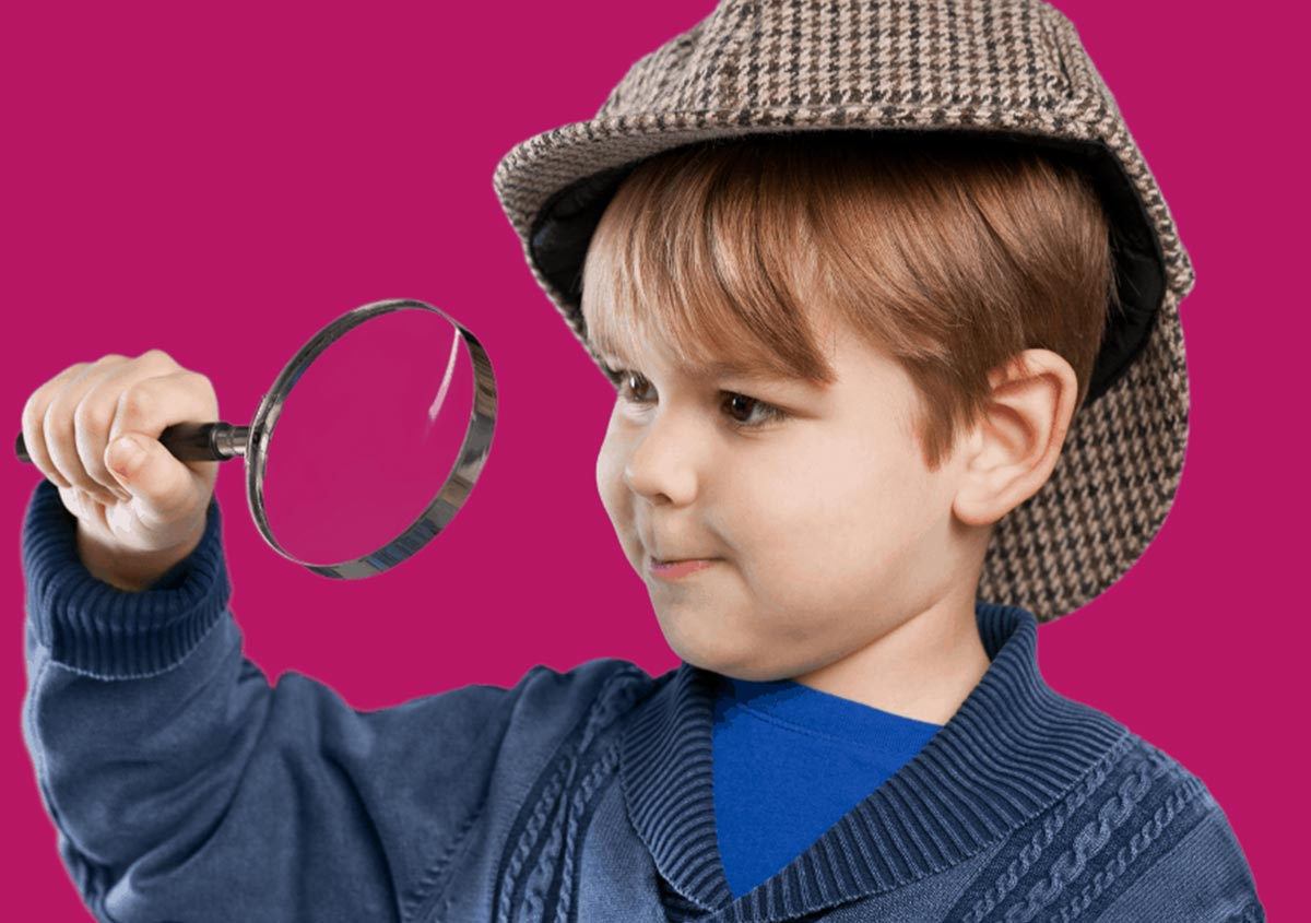 Child playing with magnifying glass
