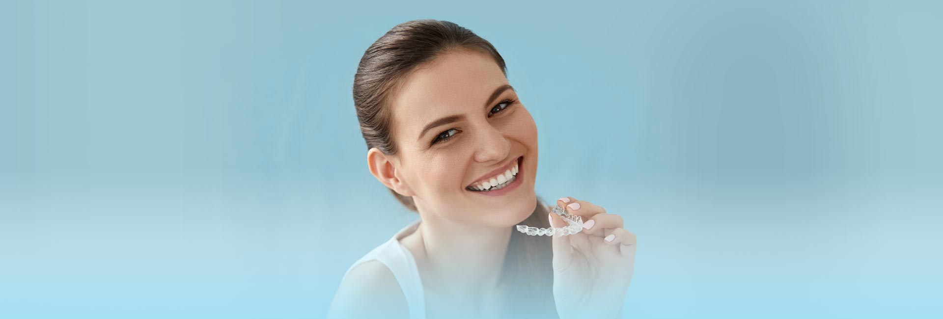 Woman smiling with dental Invisalign